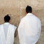 Bar Mitzvah father and son praying at the Wailing Wall, Jerusalem Israel