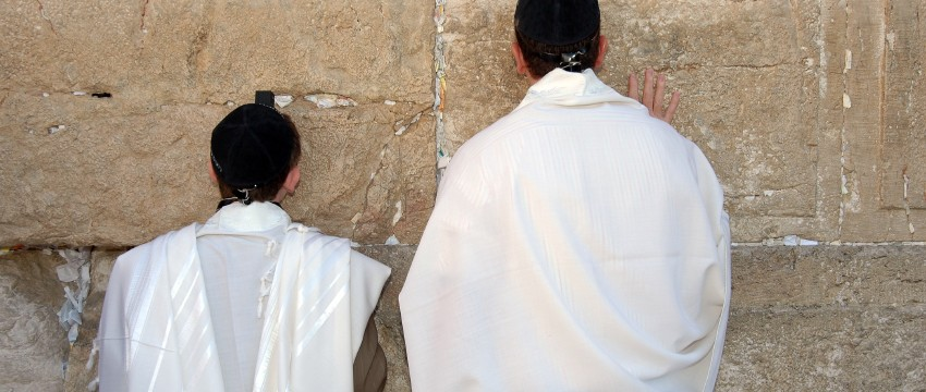 Bar Mitzvah father and son praying at the Wailing Wall, Jerusalem Israel